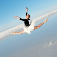 Ballerina Mid-Air Leap In Water At Salt Flats