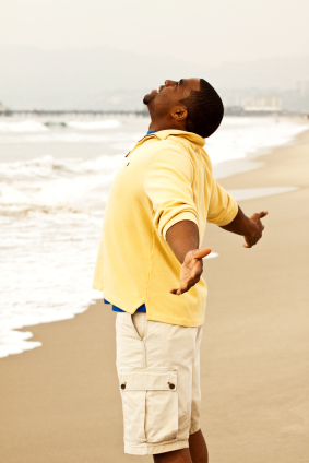 Black Man on Beach with Open Arms